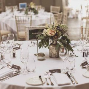 Bronze bottles dusky pink and nude wedding centrepiece flowers Blackwell Grange Barn venue florist Passion for Flowers.