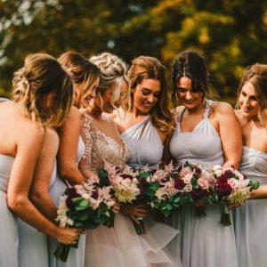 Deep burgundy blush pink flowers bridesmaids bouquets