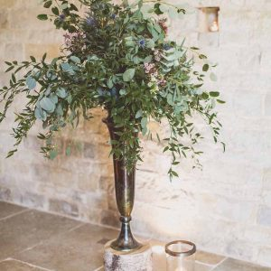 Foliage green and rustic tree stumps bronze vases barn wedding Blackwell Grange Passion for Flowers Florist