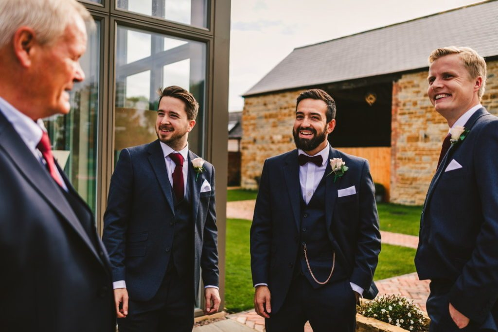 Groomsmen navy suits blush pink roses