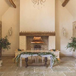Rustic Barn wedding ceremony fireplace Blackwell Grange wedding florist Passion for Flowers