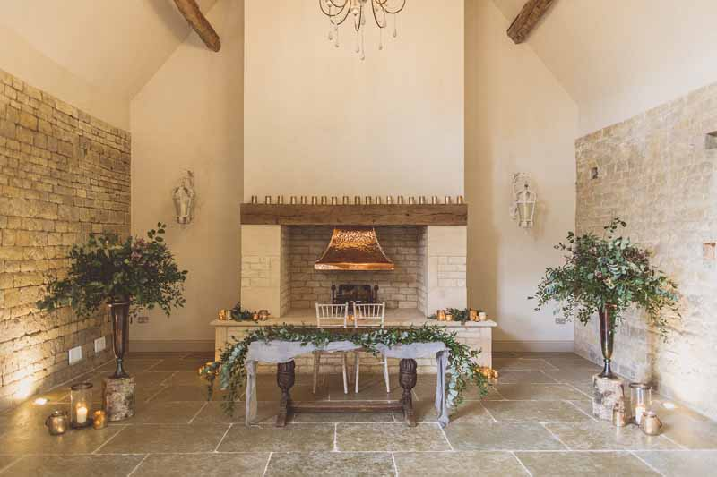 Rustic Barn wedding ceremony fireplace Blackwell Grange wedding florist Passion for Flowers