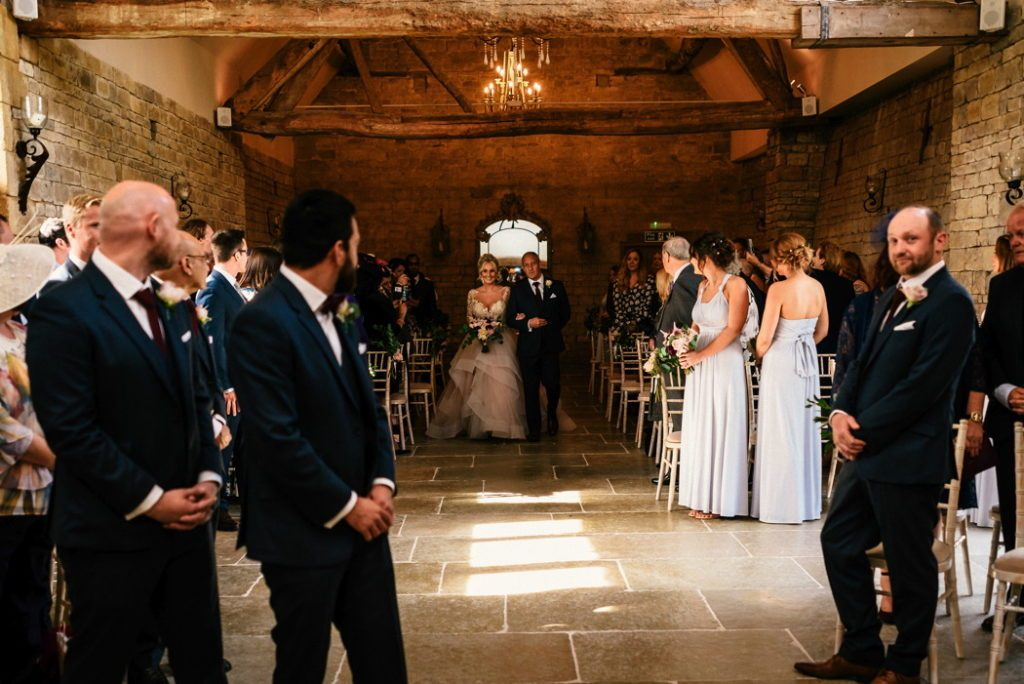 Rustic barn wedding ceremony England Blackwell Grange