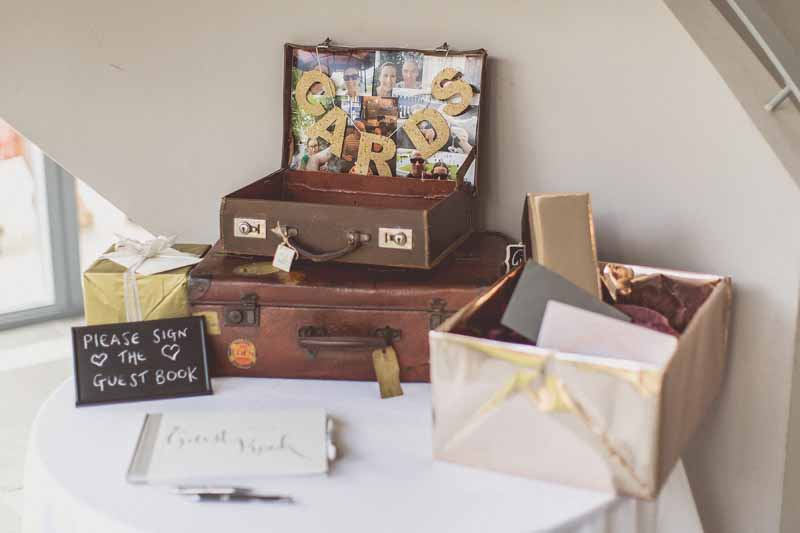 Rustic vintage wedding cards table suitcases