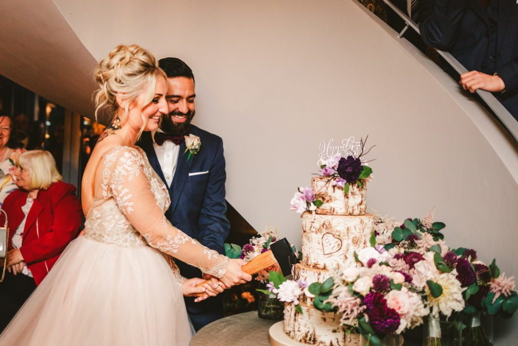 Wedding cake cutting with axe