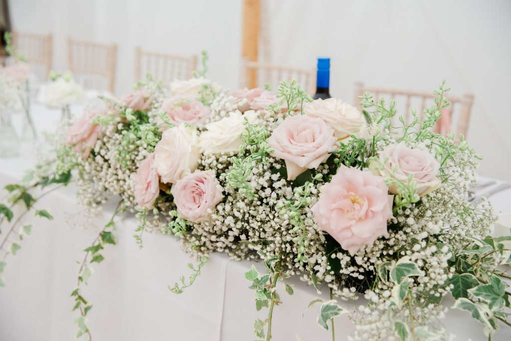 Blush pink roses babys breath wedding flowers top table marquee wedding