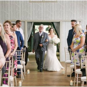 Hampton Manor wedding ceremony entrance of bride glass cylinder vases aisle decorations