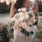stunning winter wedding bouquet grey cream green roses foliage