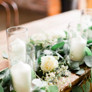 Ceremony table floral garland with cylinder vases Shustoke Farm Barns Passion for Flowers