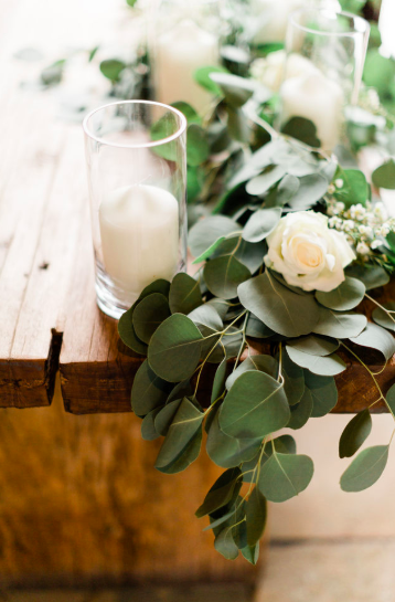 Ceremony table floral garlands with cylinder vases Shustoke Farm Barns Passion for Flowers