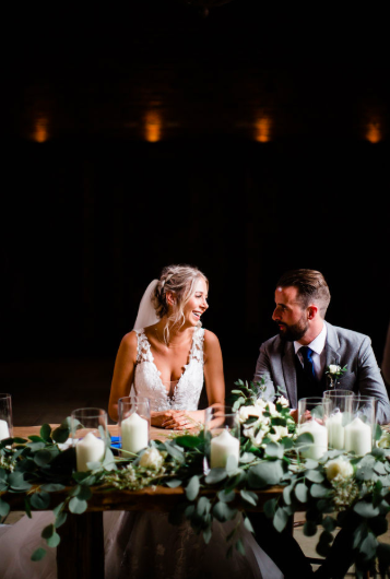 Ceremony table flowers decorations foliage eucalyptus roses and candles Shustoks Farm Barns Cripps Barn by Passion for Flowers