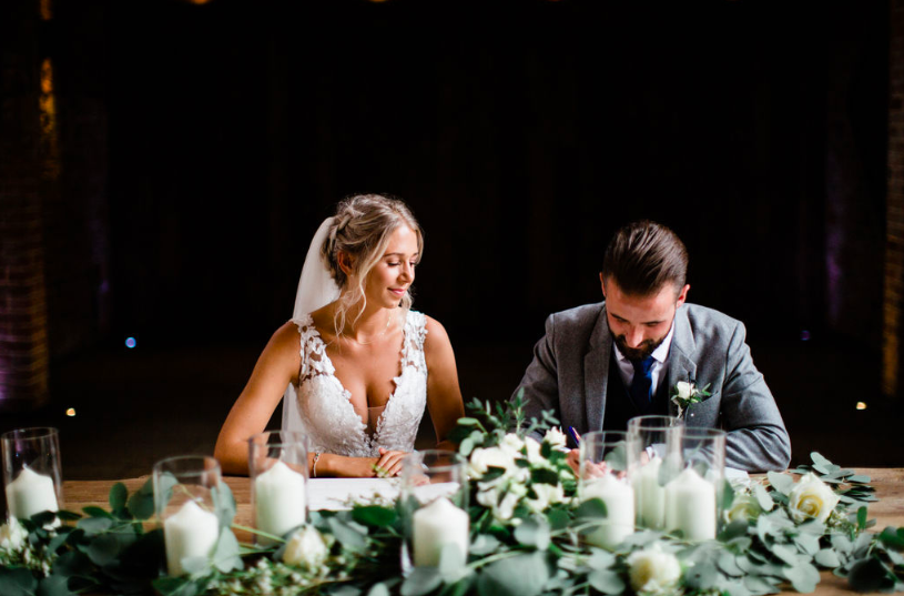 Foliage eucalyptus garland with roses and candles wedding cermony table Passion for Flowers - Shustoke Farm Barns