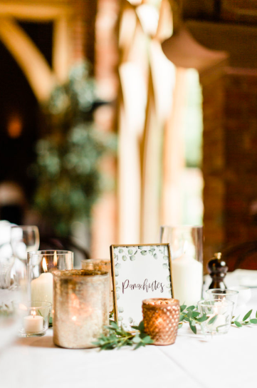 Gold bronze copper wedding centrepieces Passion for Flowers at Shustoke Farm Barns