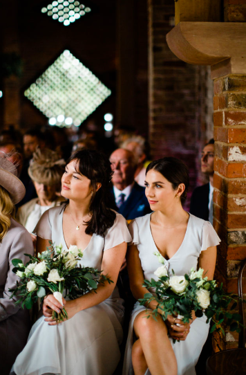 Green and white bridesmaids bouquets roses and eucalyptus foliage Passion for Flowers at Shustoke Farm Barns Cripps Barn