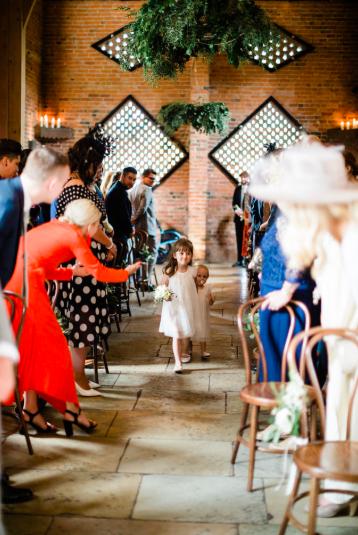 Shustoke Farm Barns wedding ceremony hangnig rings of foliage Passion for Flowers