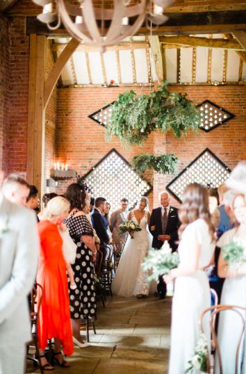 Shustoke Farm Barns wedding ceremony large hangnig rings of foliage Passion for Flowers