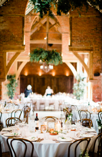 Shustoke farm barns wedding with hanging floral rings hoops Passion for Flowers