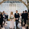 Barn wedding ceremony lots of candles lanterns - wedding florist Passion for Flowers