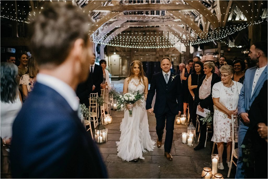 Gorgeous barn wedding with fair lights, lanterns and candles - designed by Passion for Flowers wedding florists