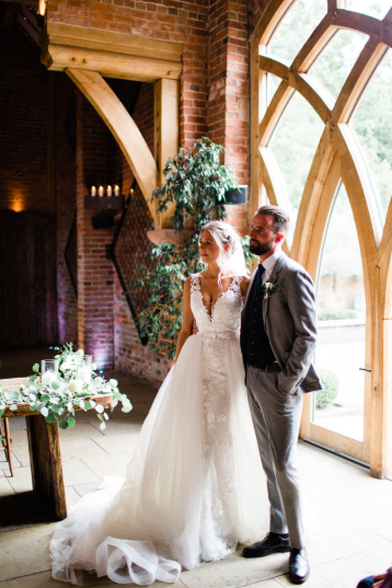 Wedding ceremony barn Shustoke Farm Barns florals on ceremony table Passion for Flowers
