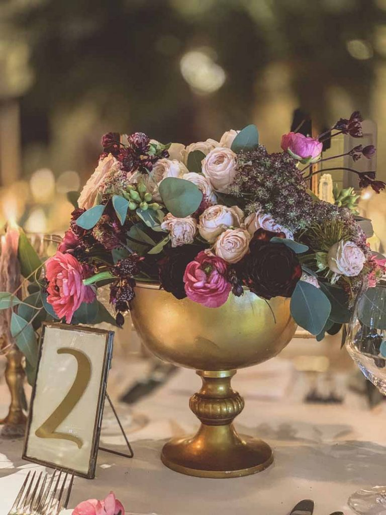Gold footed bowl wedding centrepiece with brass table numbers autumn flowers Passion for Flowers Hampton Manor florist