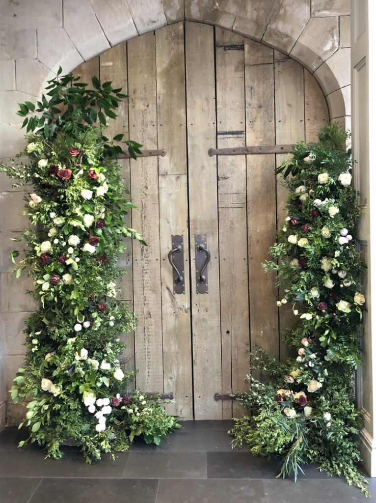 Organic style wedding arch asymmetric doorway florals by Passion for Flowers.jpg