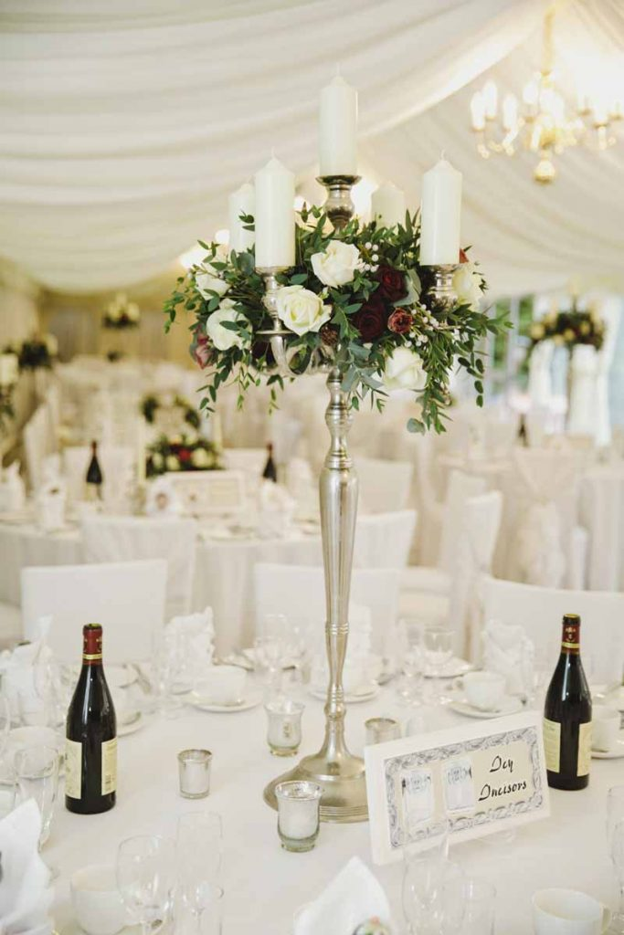 Candelabra wedding centrepieces winter wedding Birtsmorton Court Passion for Flowers