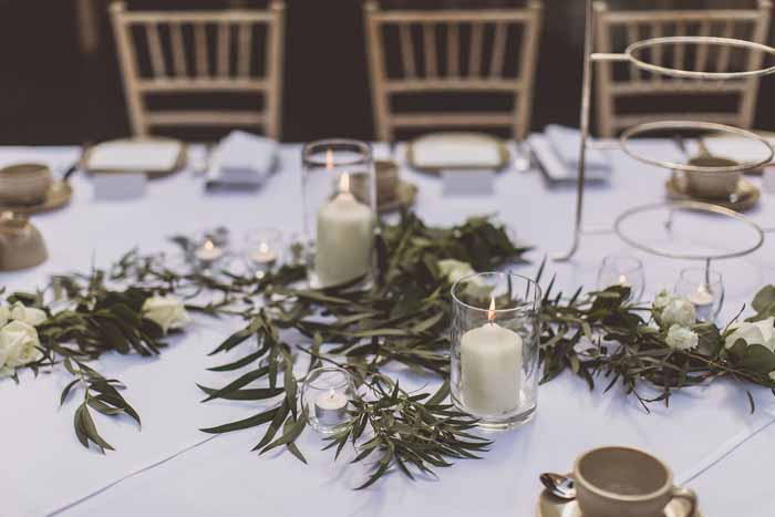 Foliage garlands along long guest tables Hampton Manor