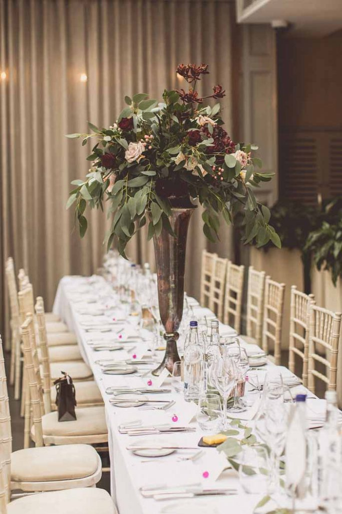 Gold bronze tall vases wedding centrepieces Hampton Manor