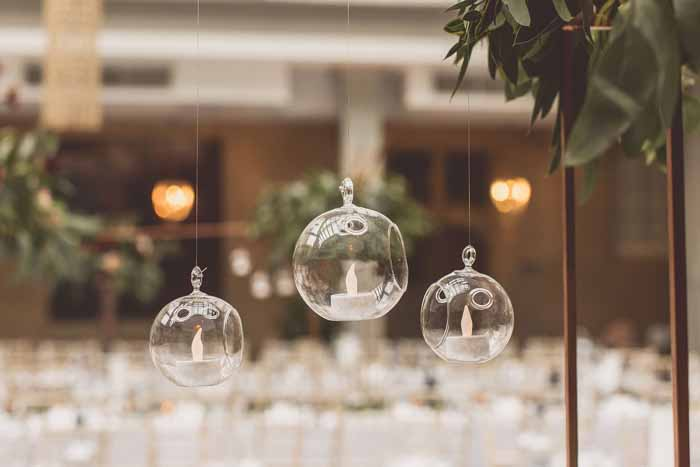 Hanging tea light baubles abouve tables wedding centrepieces