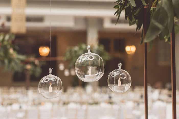 Hanging tea light baubles abouve tables wedding centrepieces
