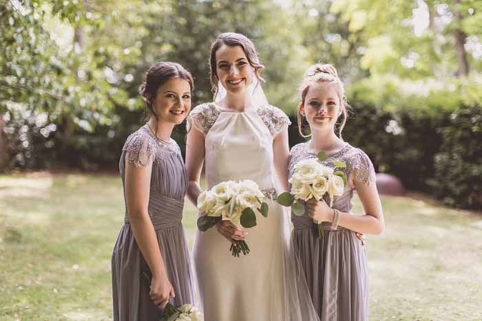 Lavender bridesmaids dresses cream rose bouquets