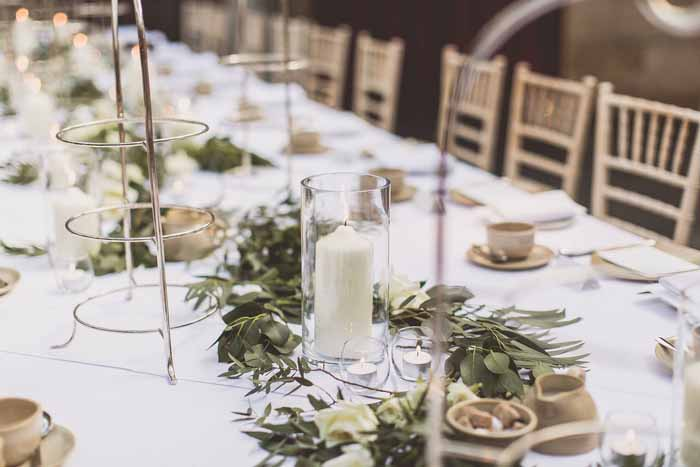 Long tables Hampton Manor simple foliage garlands with candles Passion for Flowers