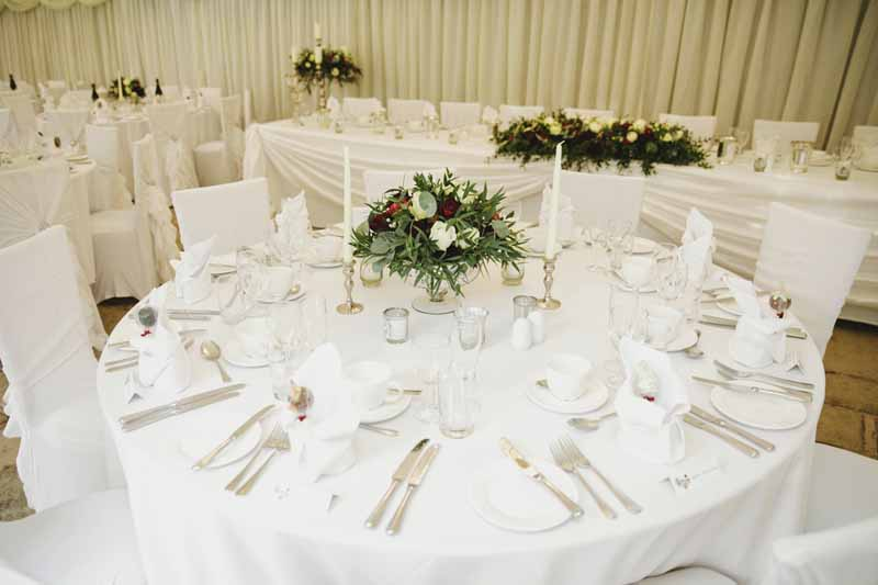 Low wedding centrepieces footed bowls winter wedding Birtsmorton Court