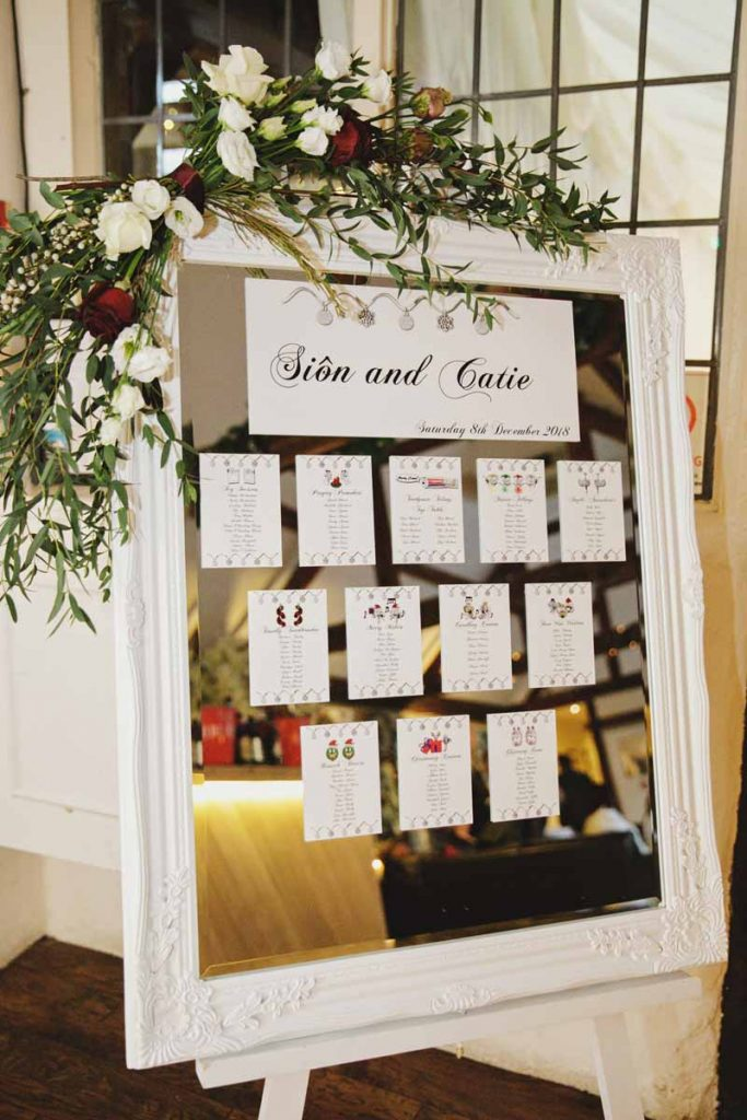 Mirror table plan with foliage garland winter weddings