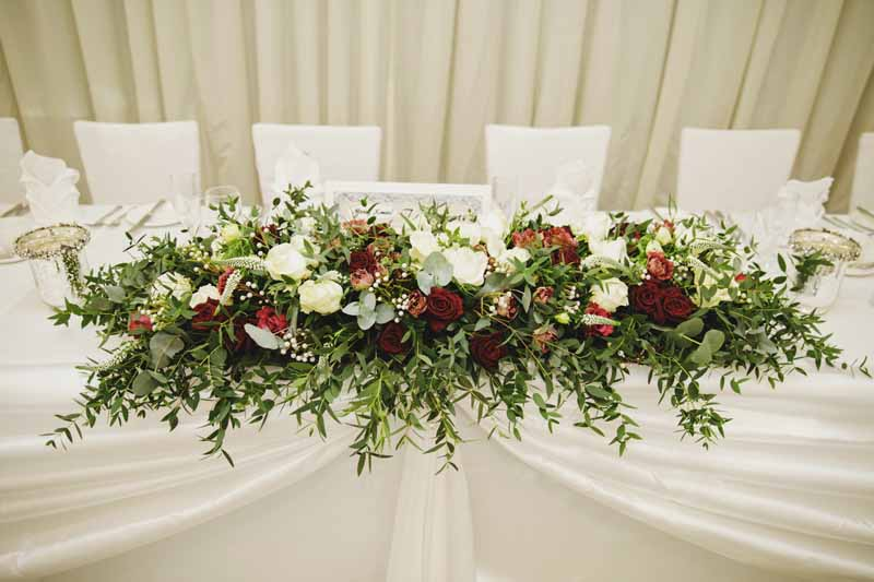 Top Table wedding long and low floral creation winter weddings