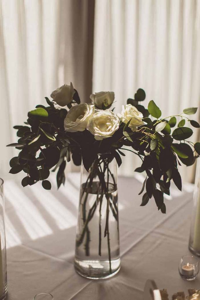 White rose and foliage flower display wedding ceremony