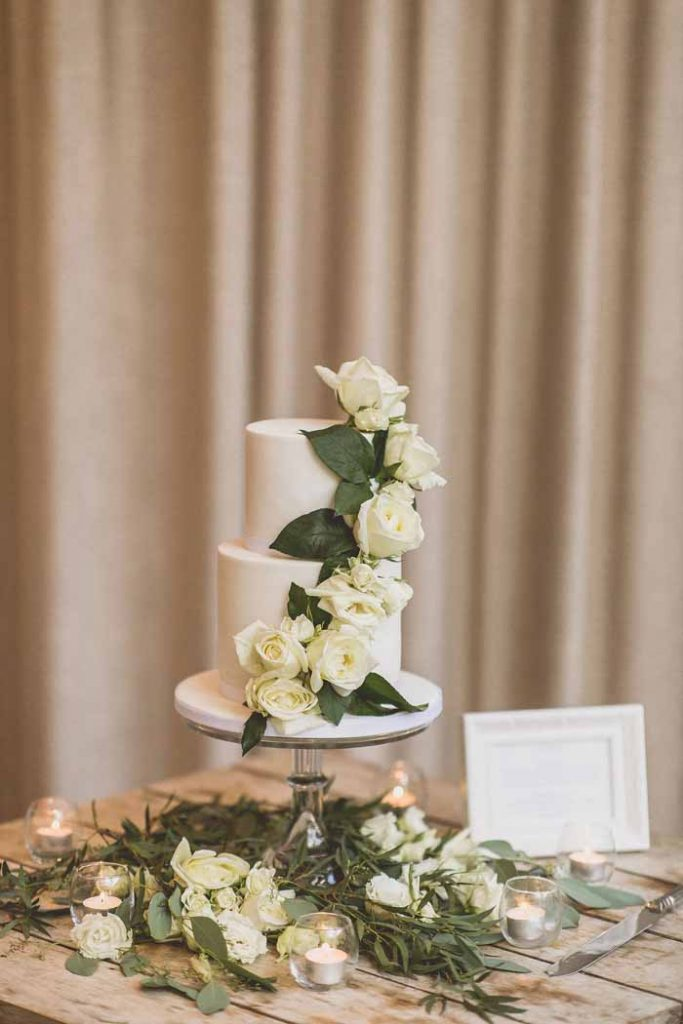 wedding cake cream roses and foliage trailing designs on cake stands