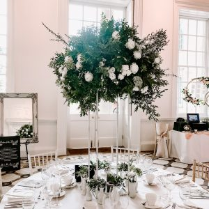 White green tall wedding centrepiece Compton Verney wedding white floral stand tall Passion for Flowers