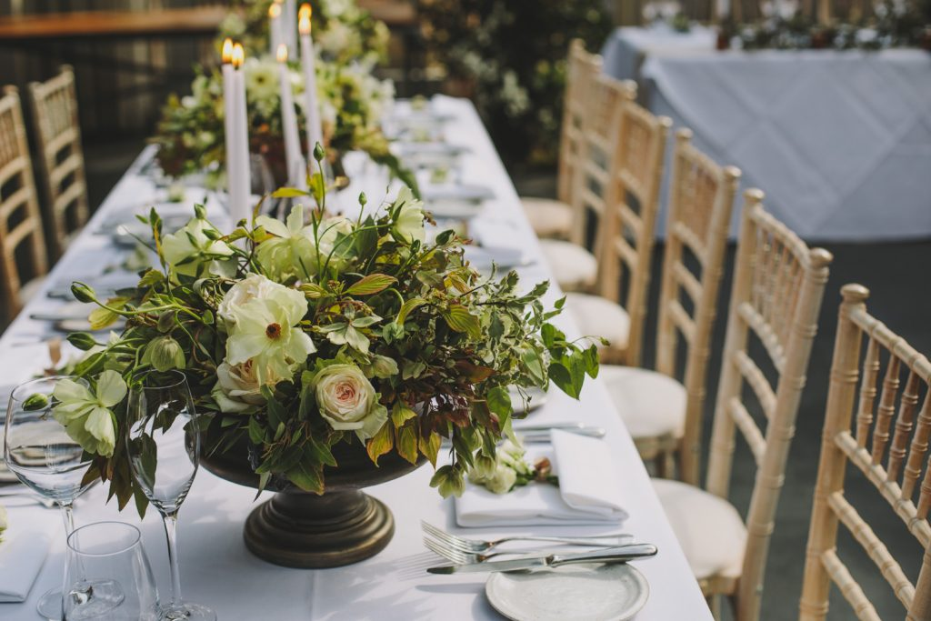 Elegant footed bowl wedding centrepieces by Passion for Flowers Hampton Manor wedding florist
