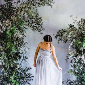Foliage green white deconstructed arch wedding ceremony asymmetric design no foam Passion for Flowers