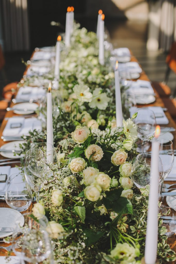 Green and white wedding garlands along tables at Hampton Manor by Passion for Flowers