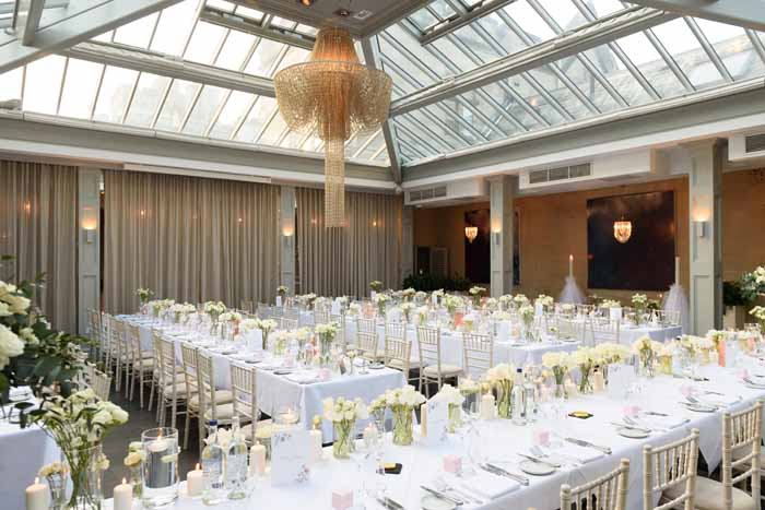 Hampton Manor long guest tables glass vases and candlelight green and cream Passion for Flowers