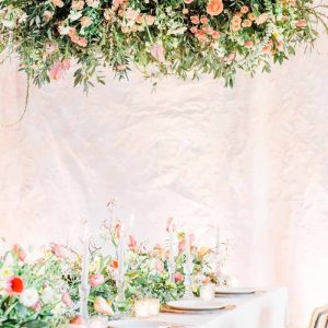 Hanging ring of flowers above wedding guest tables Passion for Flowers no foam