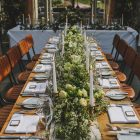 Long tables wedding flower garlands rustic barn wedding ideas