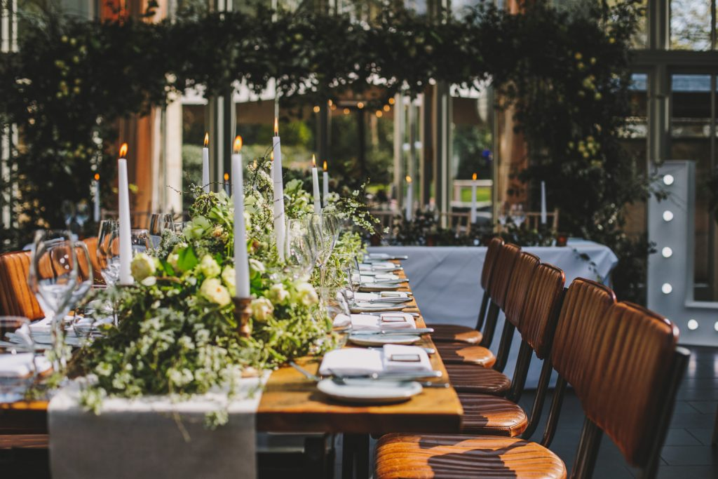 Long tables with floral garlands timeless wedding flowers Passion for Flowers