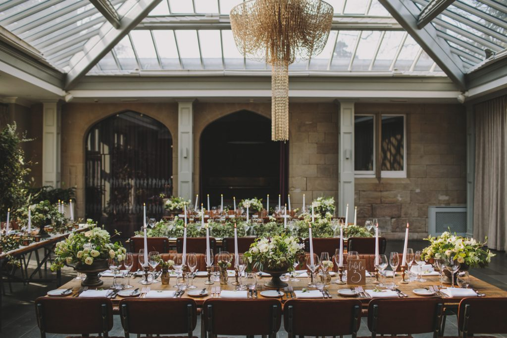 Long tables with low footed bowls wedding centrepieces by Passion for Flowers