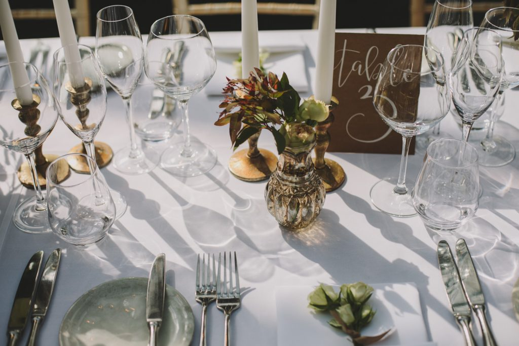 Rustic elegant wedding table styling at Hampton Manor Bronze vases candlesticks by Passion for Flowers