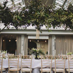 Wild foliage wedding backdrop at Hampton Manor