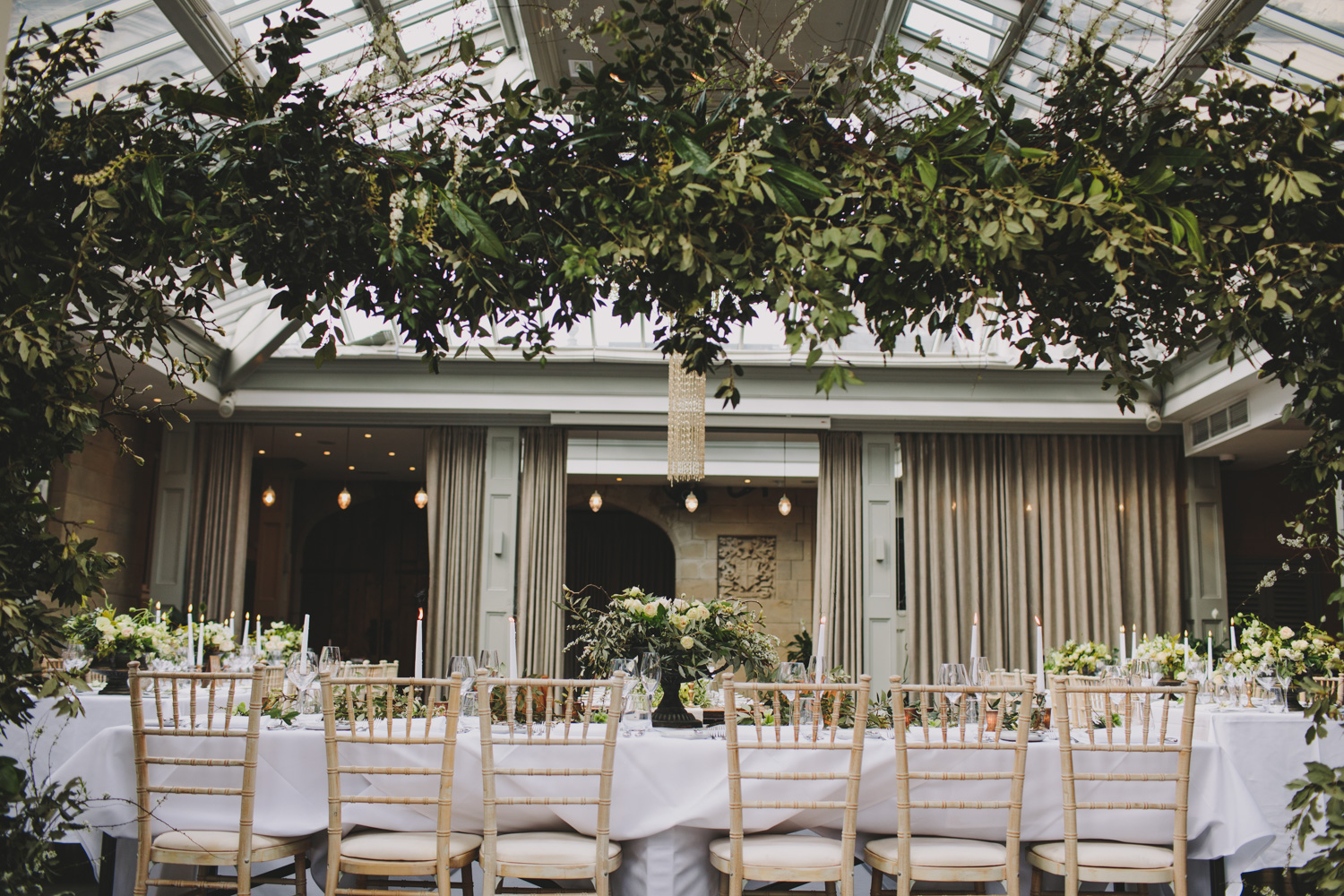 Wild foliage wedding backdrop at Hampton Manor